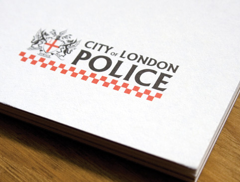 city of london police annual report cover logo close up